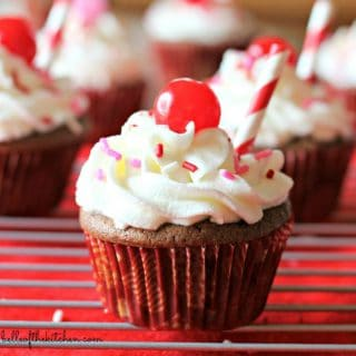 These Cherry Coke Float Cupcakes are so moist and delicious. They are stuffed with cherries then topped with a delicious whipped cream frosting!