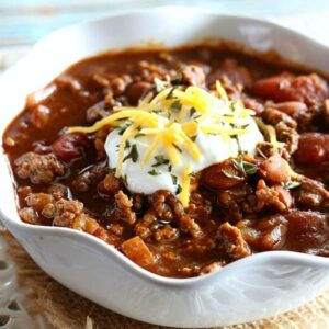 This Slow Cooker Chili is a family favorite. It's warm and hearty on a chilly night, and tastes great paired with a big, buttery hunk of cornbread.