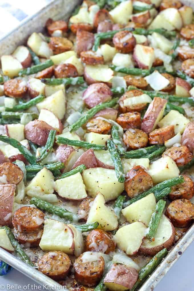 A dish is filled with food, with Sausage and Potatoes