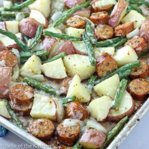 A dish is filled with food, with Potatoes and Sausage