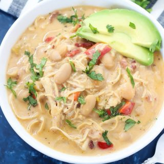 This Instant Pot Chipotle Chicken Chili is so delicious and easy to make. It's packed with bacon, beans, chicken, and plenty of smoky chipotle flavor that tastes warm and comforting on a cold day!