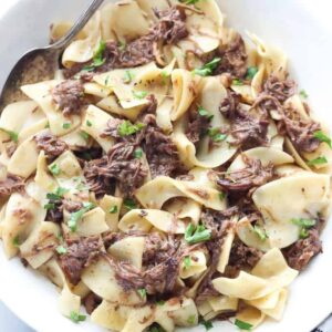 A plate of food, with Beef and Noodles