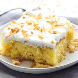 This Piña Colada Poke Cake is moist and delicious, and full of sweet tropical flavors. It's the perfect treat for warmer weather, or anytime you need a pick-me-up!