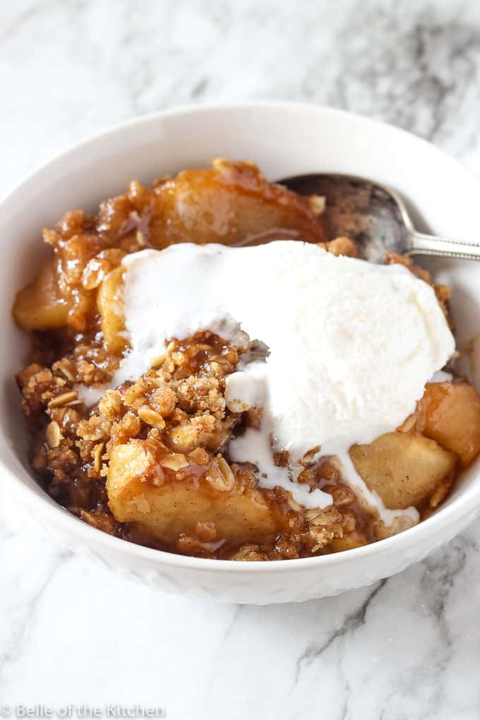 a bowl of apple crisp with ice cream on top