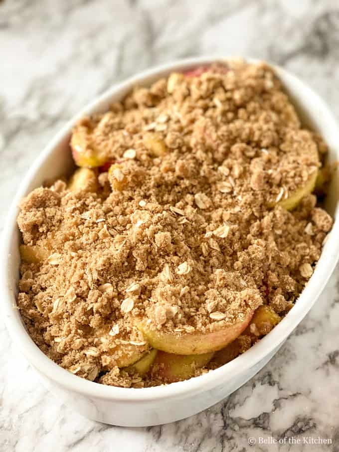 a bowl of apple crisp unbaked