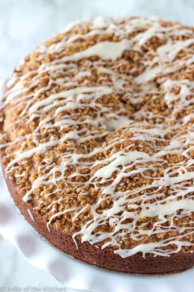 a close up of coffee cake with vanilla icing