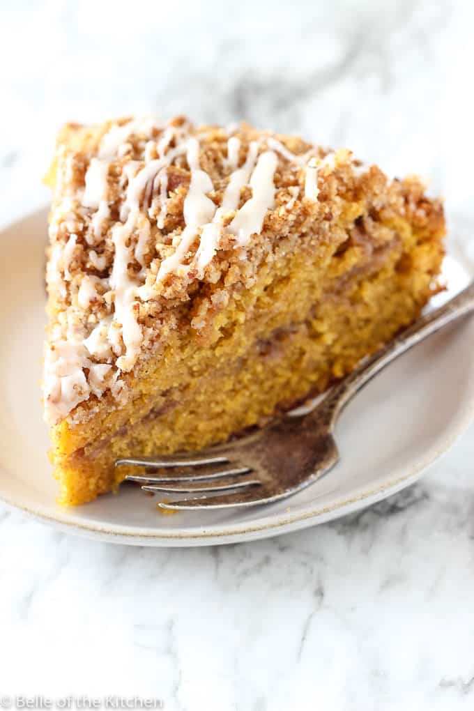 A piece of cake on a plate, with Pumpkin and Coffee cake