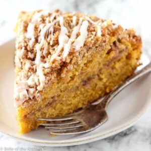 A piece of Pumpkin Coffee cake on a plate with a fork