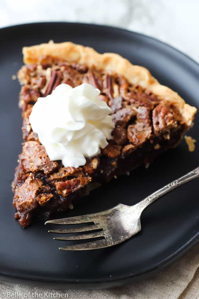 A piece of chocolate pecan pie on a plate