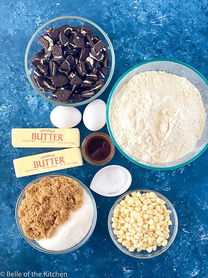 ingredients for Oreo chocolate chip cookies; butter, Oreos, flour, eggs, vanilla, sugar, brown sugar, salt, baking soda, and chocolate chips