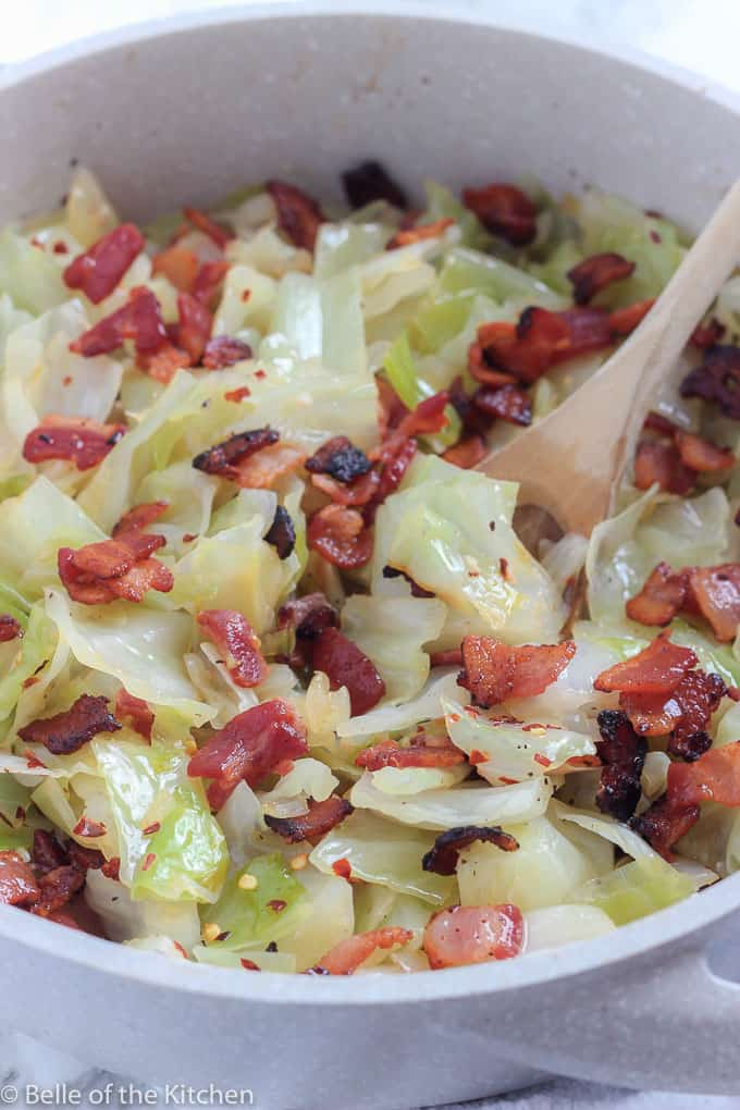 A close up of a bowl with Cabbage and Bacon