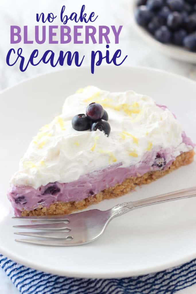 slice of blueberry cream pie on a plate with a fork