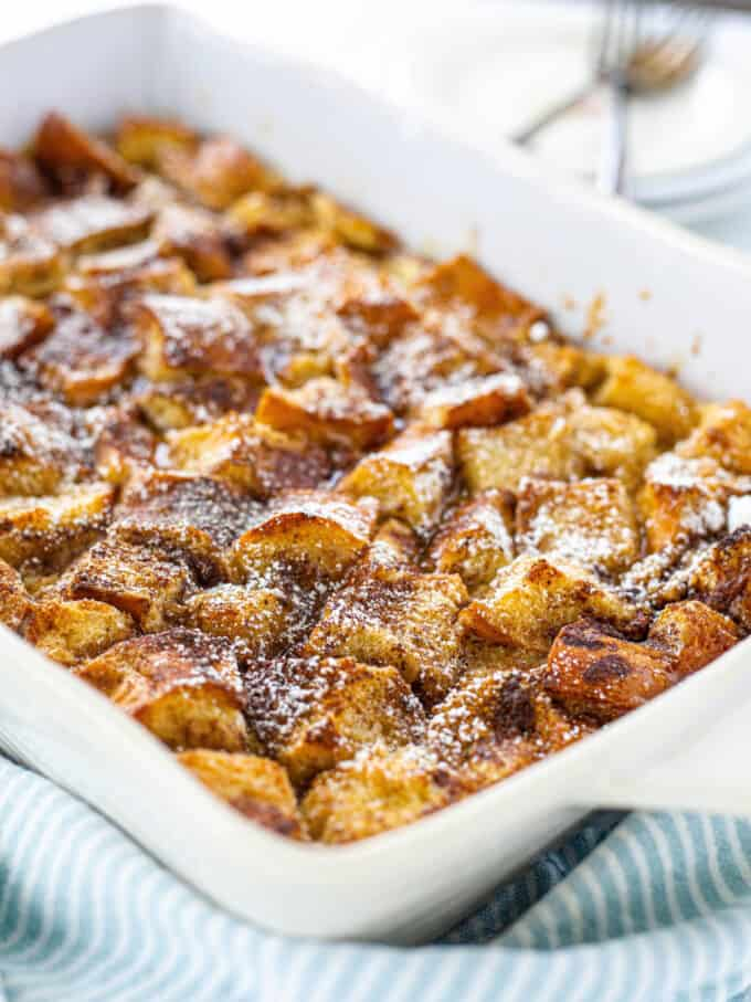a white baking dish full of french toast casserole