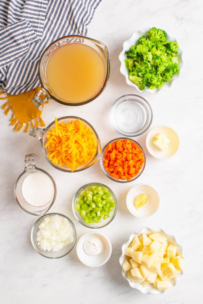 ingredients laid out in bowls to make broccoli cheddar soup