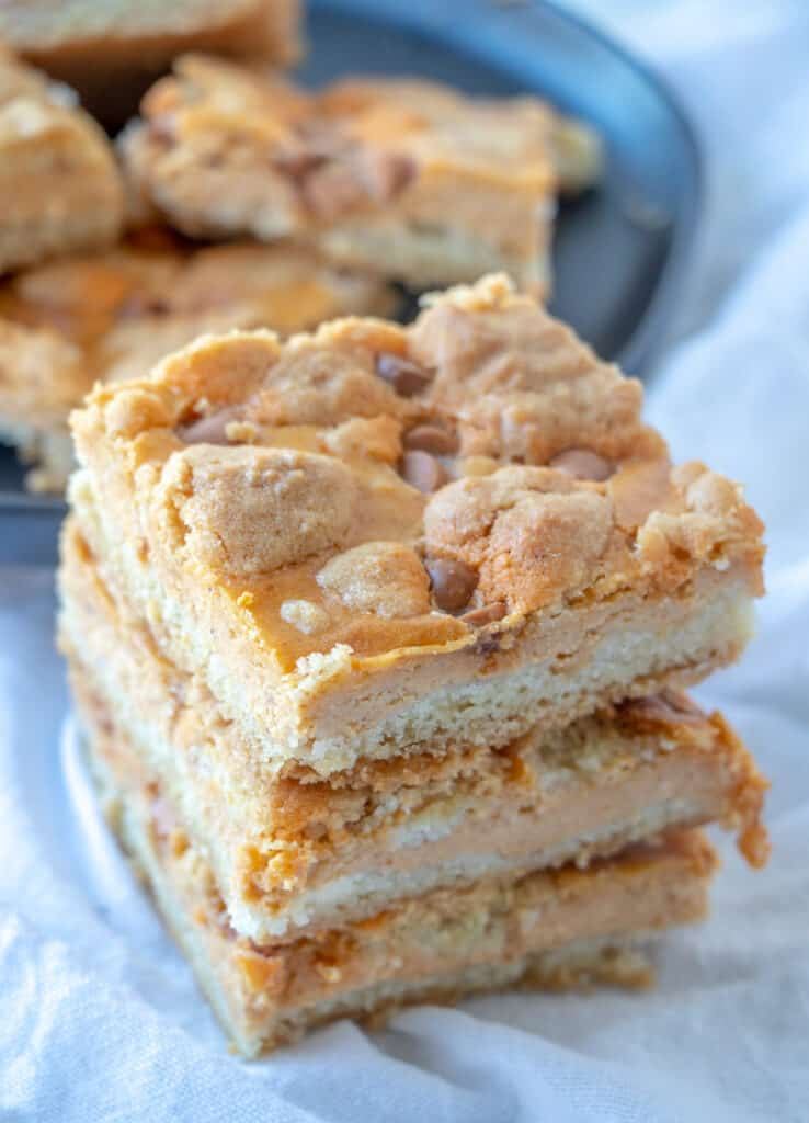 close up of a stack of pumpkin cheesecake bars