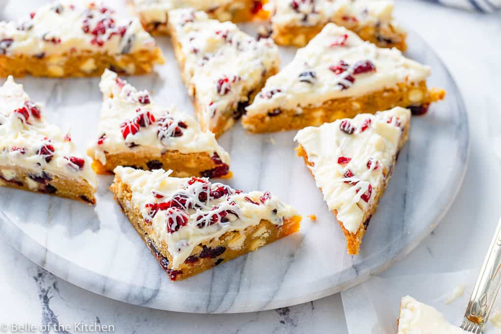 a marble tray full of cranberry bliss bars cut in triangles