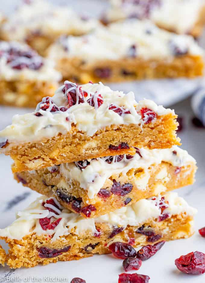 a stack of cranberry bliss bars cut in triangles