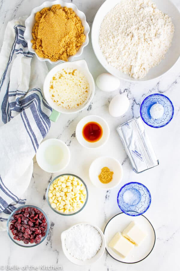 ingredients laid out on a marble background for cranberry bliss bars