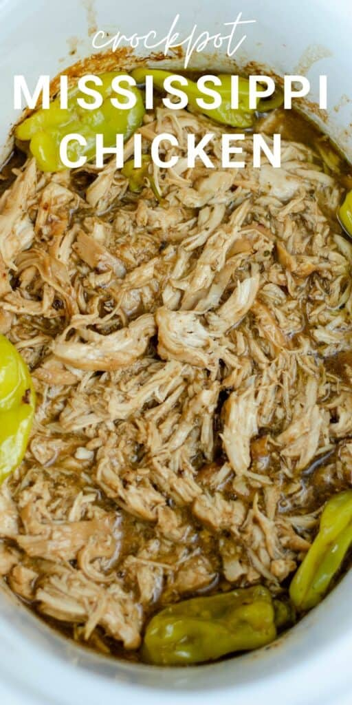 shredded chicken in a crockpot bowl surrounded by peperoncini peppers