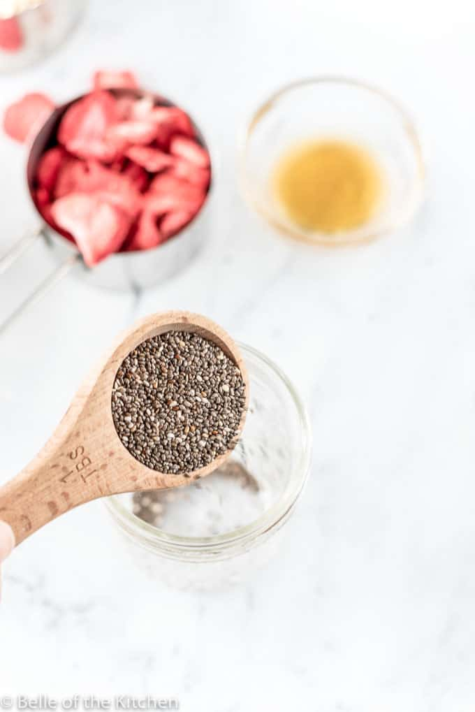 chia seeds pouring into a jar