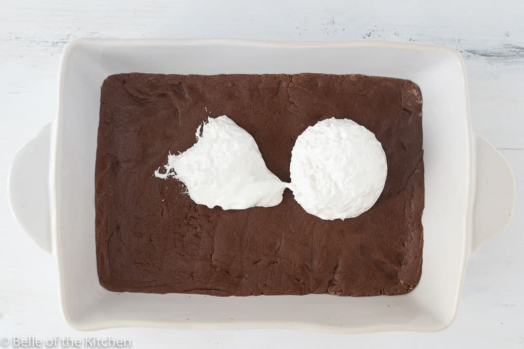 a baking pan with batter and marshmallow creme