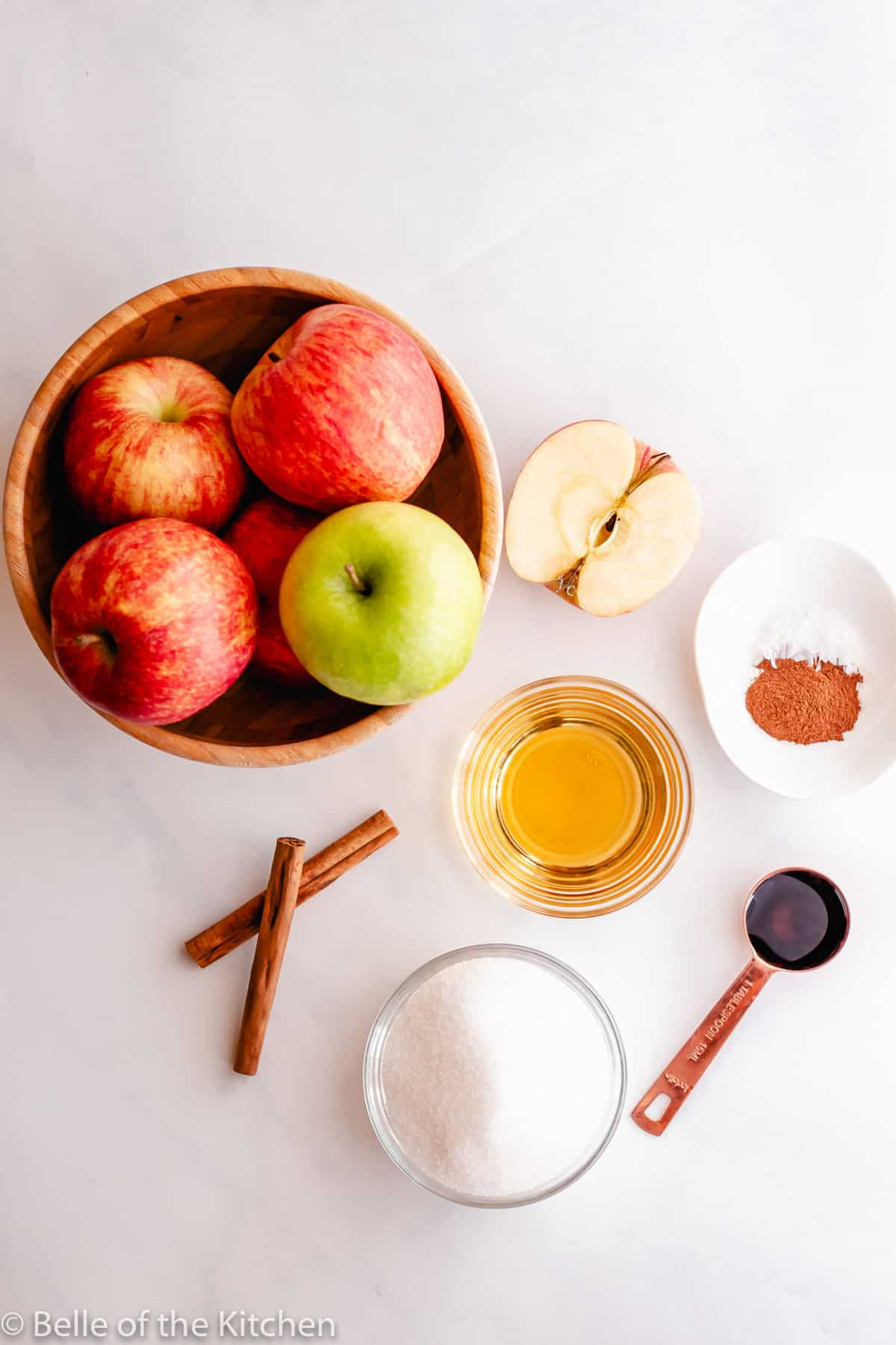 apples, cinnamon, sugar, and spices on a white board