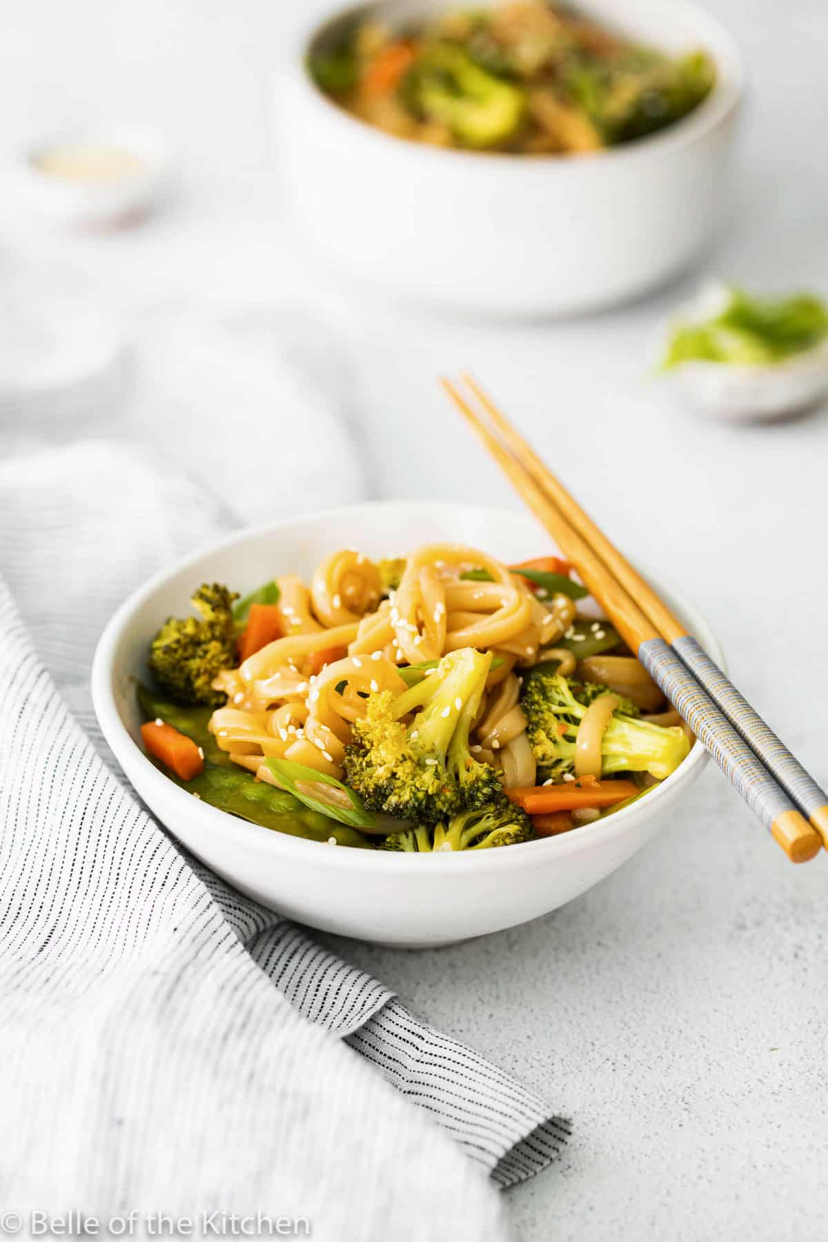 a bowl of rice noodles with chopsticks