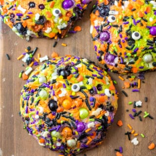 Halloween sugar cookies with sprinkles on a cutting board