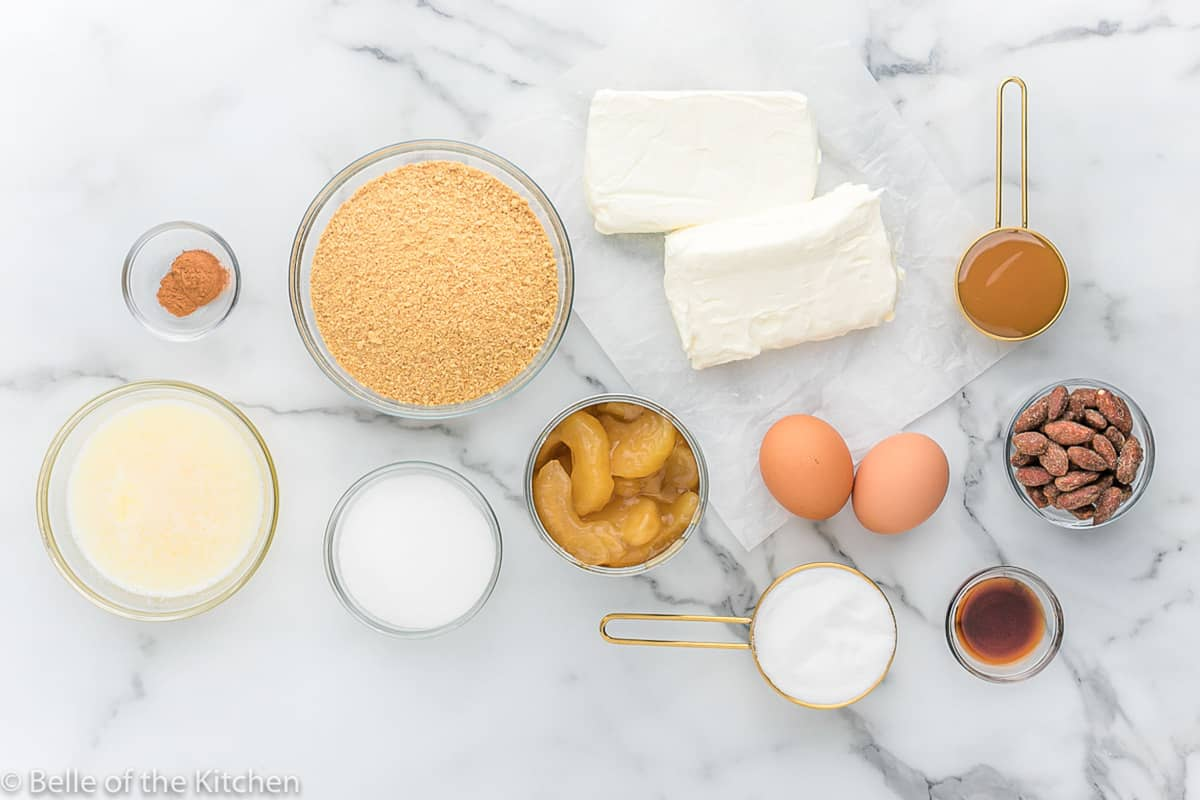 ingredients laid out to make caramel apple cheesecake