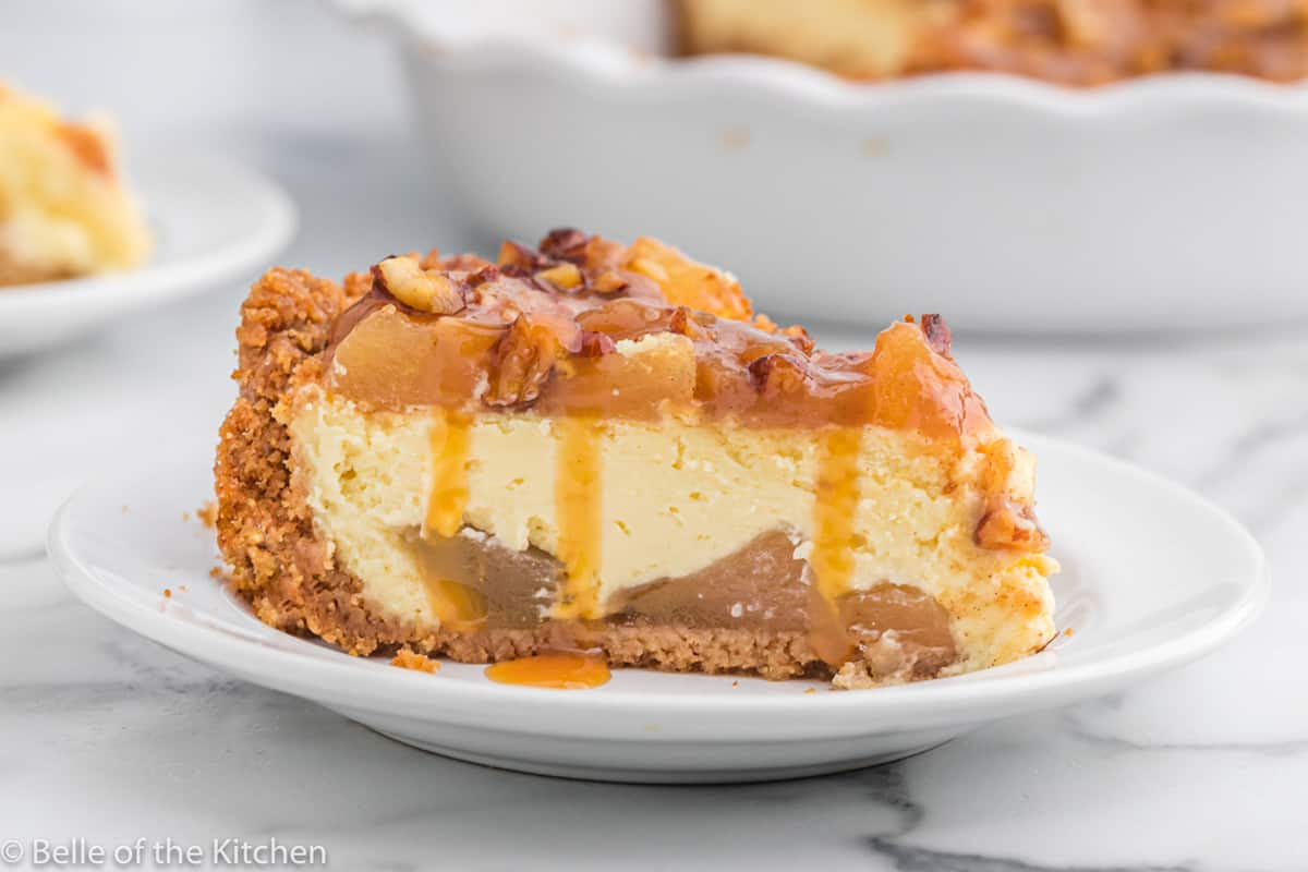 caramel apple cheesecake on a white plate