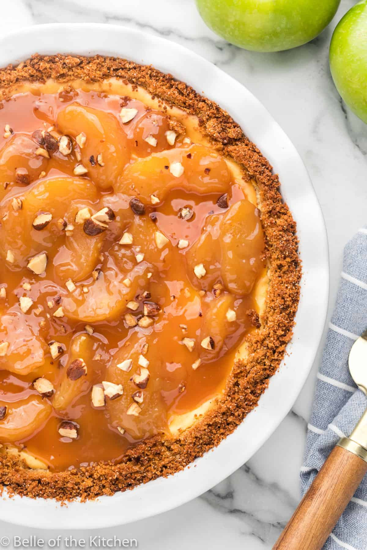 caramel apple cheesecake on a pie plate